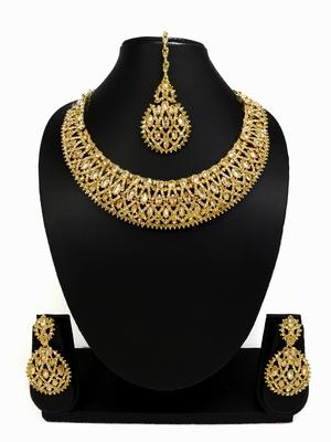 Designer golden ad zircon necklace set with maang tikka