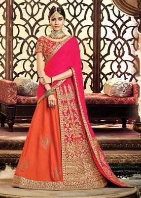 Orange colored embroidered designer taffeta silk  raw silk lahenga choli