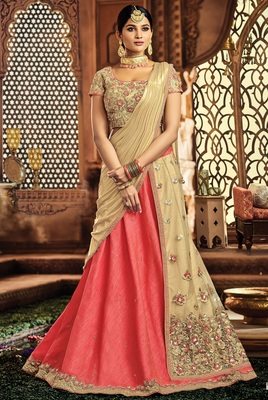 Pink colored embroidered designer raw silk  net lahenga choli