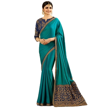 Light turquoise embroidered  saree with blouse