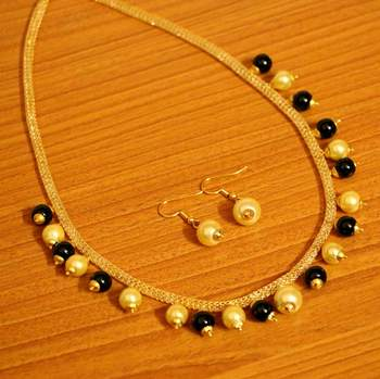Zircon Studded Black Beads  And  Pearl Necklace Set