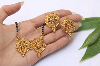 Ethnic earrings and mangalsutra