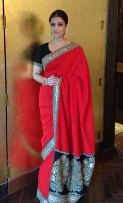 Beautiful aishwarya rai designer red georgette saree with dupion blouse and multi work on it