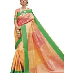 Peach woven banarasi art silk saree with blouse