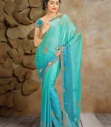 Teal and  turquoise mirror work and  beads work and  stone work silk saree with blouse