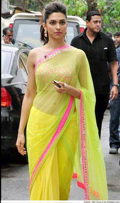 Stunning Deepika in Designer Mint Green Net saree with raw_silk blouse with Mirror work and Satin Petticoat