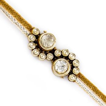 Spine Shape Golden Beads  And  Ad Studded Rakhi