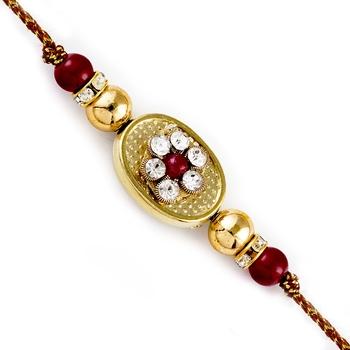 Mauve  And  Gold Beads Ad Studded Rakhi