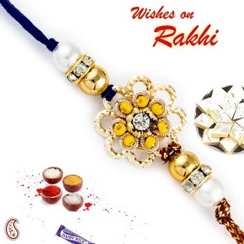 Yellow Beads  And  Ad Embellished Floral Motif Rakhi