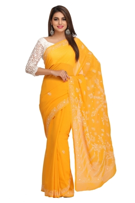 Mustard embroidered faux georgette saree with blouse