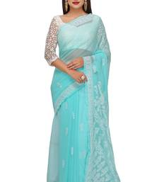 Sea green embroidered faux georgette saree with blouse