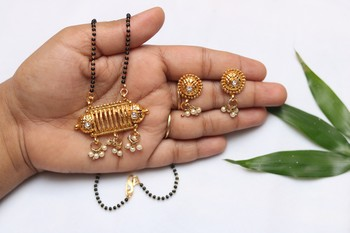 Gold tone mangalsutra with dangling pearls