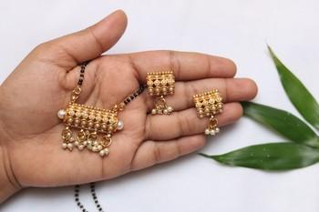 Elegant dangling pearls gold tone mangalsutra