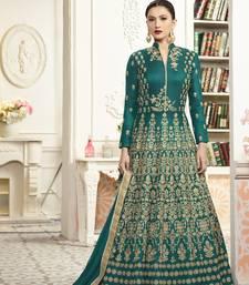 Green silk semi stitched salwar with dupatta