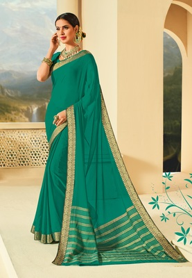 Green raw silk saree with blouse