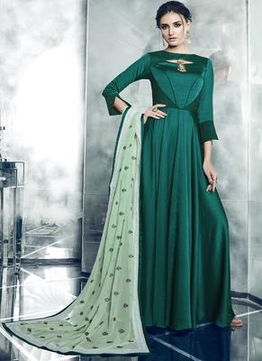 Dark green embroidered satin stitched salwar with dupatta