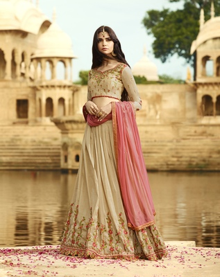 Beige embroidered silk semi stitched lehenga with dupatta
