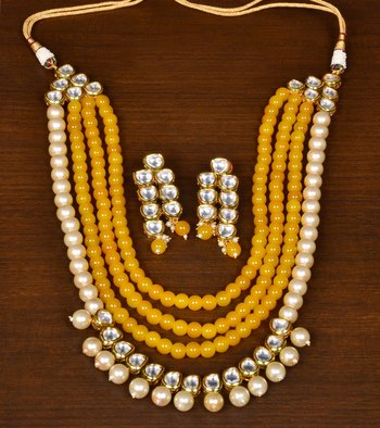 Yellow Colored Pearls, Stone and Kundan Embellished Splendid Designer Multi-layered Necklace Set for Women