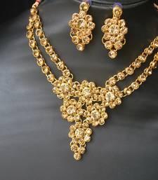 Buy Gold stone studded floral link wedding necklace set jewellery-below-500 online
