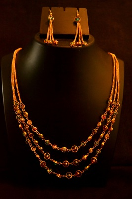 53ac8136ed167 Designer semi precious stone golden multistrand chain necklace set with  matching earrings