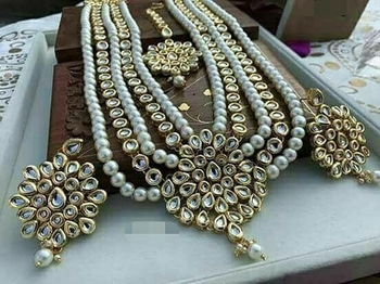 Kundan And Shell Pearls Necklace Set With Earrings And Mangtikka