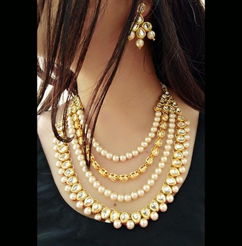 Gold Plated Kundan And Shell Pearls Multilayer Necklace Set