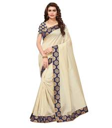 Cream solid art silk saree with blouse