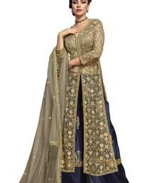 Beige embroidered net salwar with dupatta