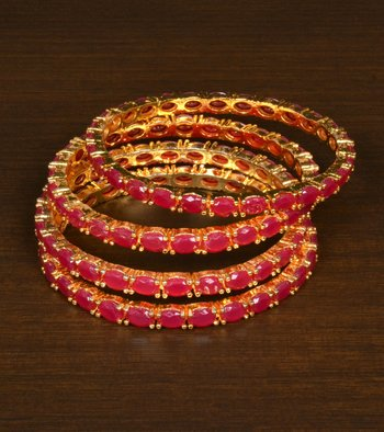05c52c42ee8e4 Gold plated red stone embellished designer wedding bangles for women