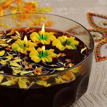 Aapno Rajasthan Yellow Flower Wax Candle Diyas- Set Of 4