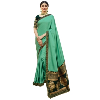Green woven faux georgette saree with blouse