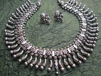 Oxidized neck piece