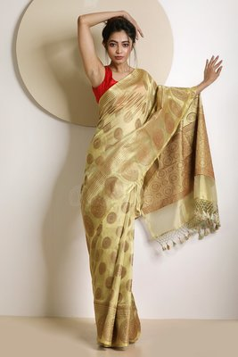 Beige hand woven tissue saree with blouse