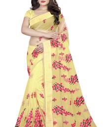 Gold embroidered net saree with blouse