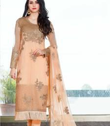 Peach embroidered net salwar with dupatta