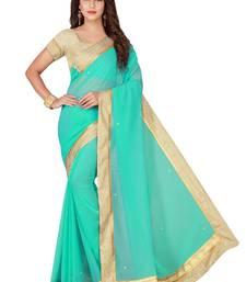 Turquoise plain faux chiffon saree with blouse