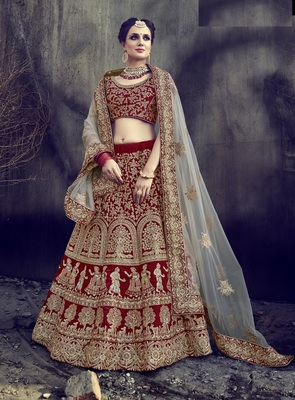 Red embroidered velvet lehenga with dupatta