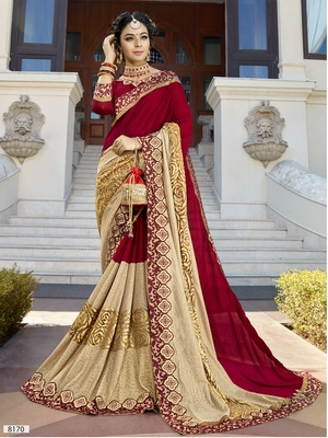 Maroon and golden embroidered georgette saree with blouse