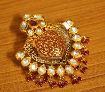 Red ruby brooch