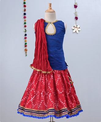Red Bandhini Ghagra with a Blue tie back choli and Red Dupatta