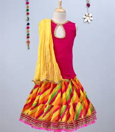 Multicolored Bandhini Lehenga with Pink tie back choli and yellow dupatta