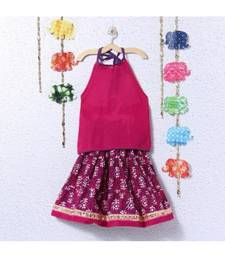 Dark Pink Printed Lehenga With A Plain Pink Top And Pom Pom Hangings