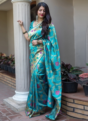 Sky blue woven banarasi art silk blend saree with blouse