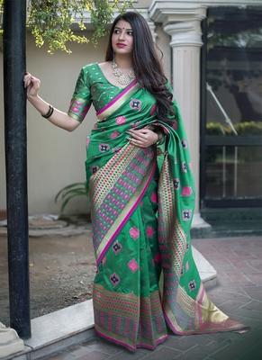 Green woven banarasi art silk blend saree with blouse