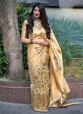 Cream woven banarasi art silk blend saree with blouse
