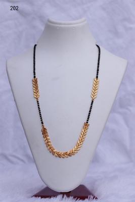 Gold emerald mangalsutra