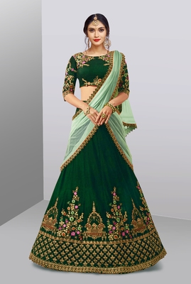 Stunning Dark Green Colored Beautifully Embroidered Tapeta Silk Lehenga Choli For Wedding