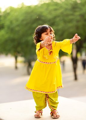 Yellow embroidered crepe kids tops