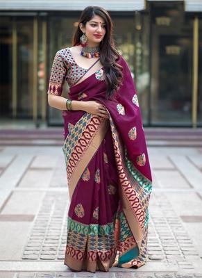 Wine woven banarasi silk blend saree with blouse