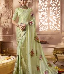 Light parrot green printed georgette saree with blouse